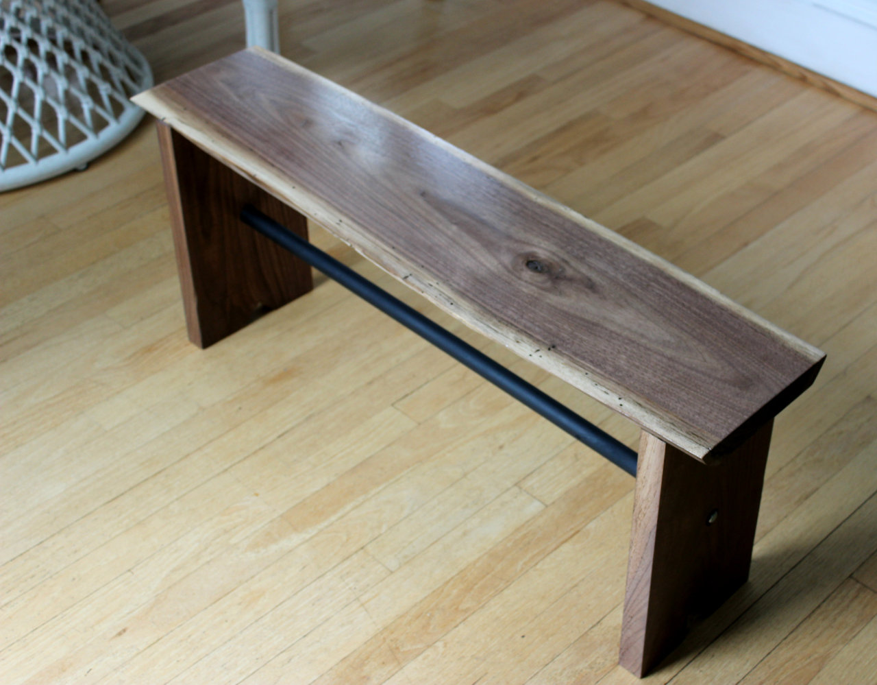 philipgooldfurniture:  I've had this piece of Walnut for a few months now and finally made the decision to make a bench with it. The legs are solid Walnut as well. I put sort of a contemporary spin on it with the dowel underneath finished in a flat black.