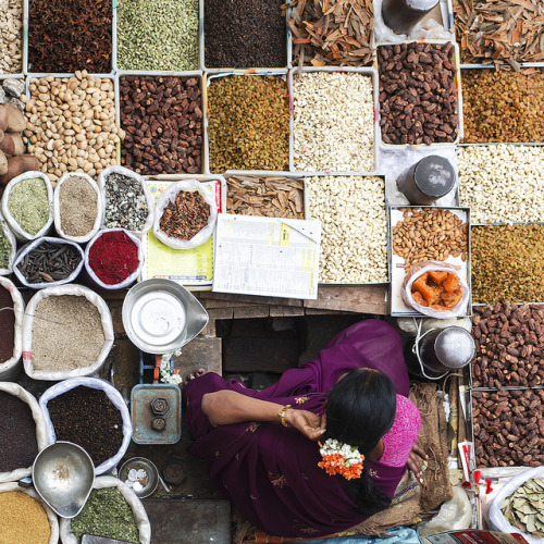 allasianflavours:  A Women selling dry spices at KR Market, Bangalore. These ingredients forms a essential part of every Indian's spicy food by Rajagopalan Sarangapani