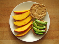 dearfatyouarenotwelcome:  garden-of-vegan:  mango, and a whole wheat english muffin with peanut butter, and avocado  this looks soo delicious…it's a pity i don't like mango