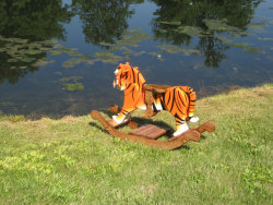 http://www.etsy.com/listing/78080239/travis-the-wooden-rocking-tiger?ref=sr_gallery_1&ga_search_query=tiger+rocking+horse&ga_view_type=gallery&ga_ship_to=ZZ&ga_search_type=all