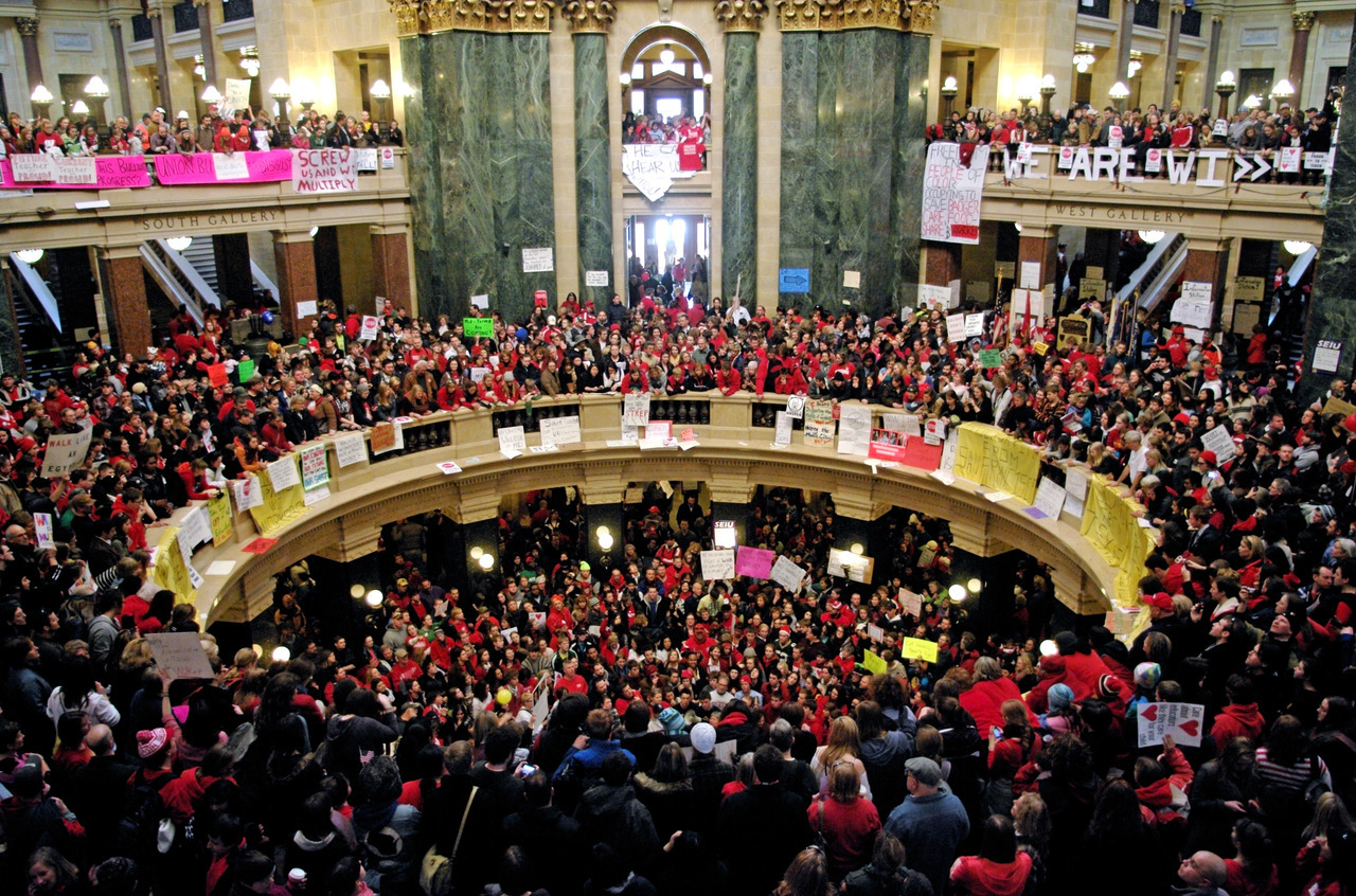 Protestors fill the Capitol building in Madison, Wisconsin. Labor demonstrations during February 2011, when Governor Scott Walker introduced an anti-union bill.