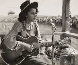 lauramcphee:  Young girl and guitar, Rosebud Sioux Fair, c1940 (Helen Post)