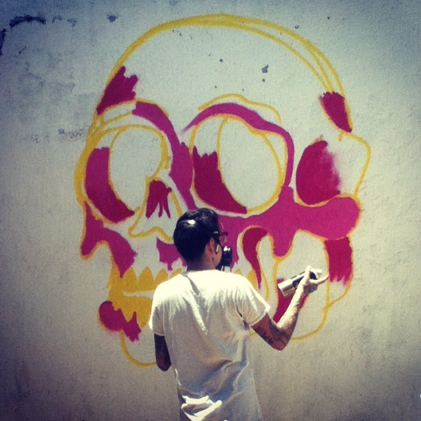 #cougartooth painting one of the patio walls in our casita!  💀👍💜