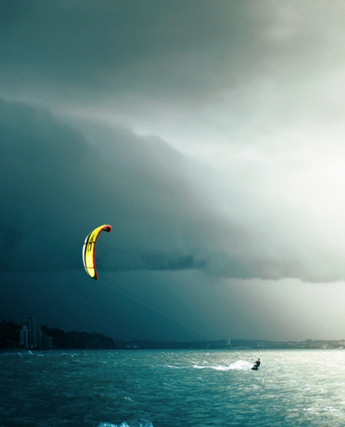 imposinggod:  Night Kite Surfer  more like flying bananaaaa