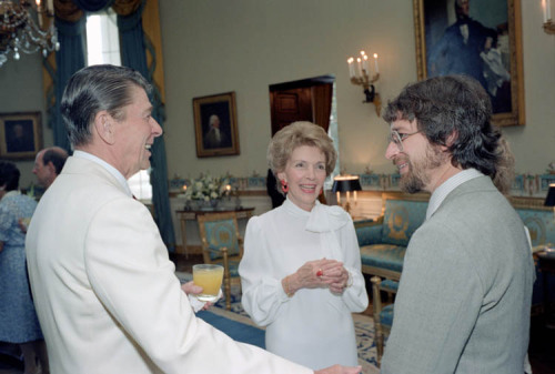 "President Reagan and Nancy Reagan talking to Director Steven Spielberg in the Blue room during a Private Dinner and showing of the movie ""'ET"". 6/27/82."