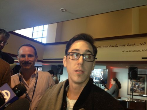 Sure Tim Lincecum's haircut is news, but look at how happy dude to the left of him is…