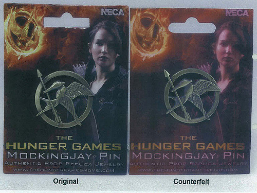 Mockingjay pin: Original vs Counterfeit, Can you tell the difference? (x)