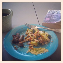 My peaceful Sat morning breakfast. :) protein style! Veggie sausage, avocado, eggs scrambled with brocolli, red onion and chickpea veggie pattie, feta cheese and Sriracha on top. Earl Grey tea and an amazing book. Not trying to brag just happy :)