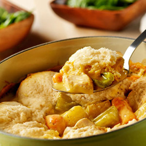 Daily Bite: Slow-Cooker Chicken and Dumplings The slow-cooker simmers chicken, potatoes, carrots and celery in a creamy sauce and is topped with tender dumplings made easy and delicious with baking mix.