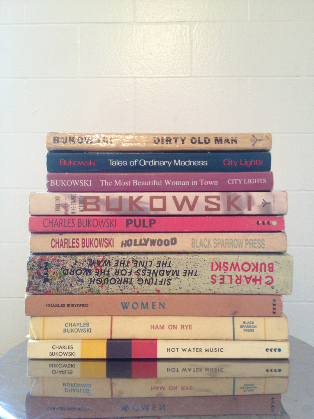 patsyclash:    My Charles Bukowski books collection Dirty old manTales of ordinary madness Portions from a wine stained notebook Pulp hollywood Sifting through the madness for the word the line the way women ham on rye hot water music bukowski charles city lights black sparrow press