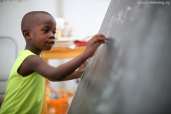 Haiti A young boy practices writing his letters during class in Haiti. Take a moment today to pray for vulnerable children in Haiti and around the world—pray that each child would have access to the education they need  to rise up out of poverty.  Sign Up to get Photo Prayer of the Day sent to your inbox!