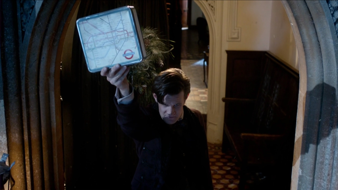 "London Underground Map Tin in the Doctor Who Christmas Special, ""The Snowmen"" It's not very often I get to combine two of my absolute favourite things in one post: Doctor Who and transit maps! Without giving too much away (spoilers, sweetie!), the tin is presented in-story as being from 1967, and it looks like the BBC props department did a pretty decent job. The map shown on the tin is indeed Paul Garbutt's 1964 map, which can be differentiated from the very similar 1970 map — even on-screen like this — because of the enlarged ""U"" and ""D"" in the ""UNDERGROUND"" roundel. By 1970, all letters in the logo were the same height. There is actually a very clever point to the exact dating of the tin to 1967, but again… spoilers!"