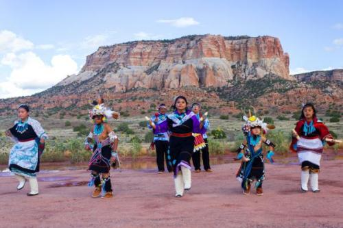 Dancing From the Heart—Zuni Dance Troupes Rehearse at Their Sacred Corn Mountain The late afternoon sun slanted through puffy clouds and played over the surface of Zuni Pueblo's sacred Corn Mountain. Small golden heads of wild sunflowers dappled the field at the base of the mesa, which rises 1,000 feet over the pueblo's western New Mexico village. Against this imposing high-desert backdrop, a dance rehearsal got under way.