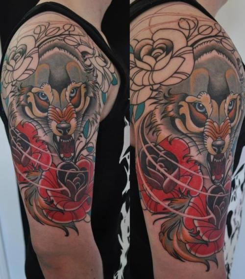 fuckyeahtattoos:  My boyfriends first tattoo. A wolf and English roses (since he's English)Six hours, got 2 more hours to go. For a first tattoo, he sat there and didn't even flinch! Done by Rhys at Empire Tattoo (Adelaide, Australia). He's an amazing artist, he's doing my tattoo in a week and I couldn't be more excited!