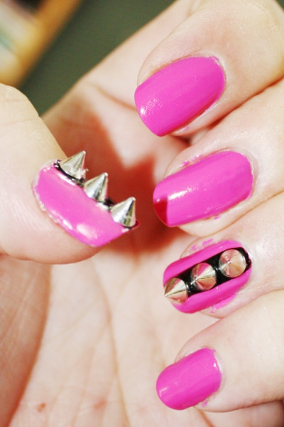 nailmetothewall:  Manicure - May 3rd 2013 Sorry I totally didn't clean up, I was in a hurry and my battery was dying. I have a special event where I was guest speaking at and I just had to do awesome nails! I had bought these little metal spikes off the internet and wanted to use them… I didn't want the look to be too over the top, so I just went witch accent nails. Just one kind of looked off kilter so I did thumb and ring finger on both hands… It's definitely a one day special manicure.. but I love it, especially the bright pink with the black and metal. 1x Orly bonder 2x Orly Basket Case (Nice bright barbie pink) pinky, middle and pointer finger: 1x seche vite thumb and ring: jordana black striper Nail art metal spikes 3x seche vite