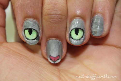 nail-stuff:  Cat nails! I just got a request to do these and I thought they'd be kinda cool to do! (And I have a slight obsession with the feline species, but we don't need to go into that… heh heh) For the background I used Sidewalkers by NYC