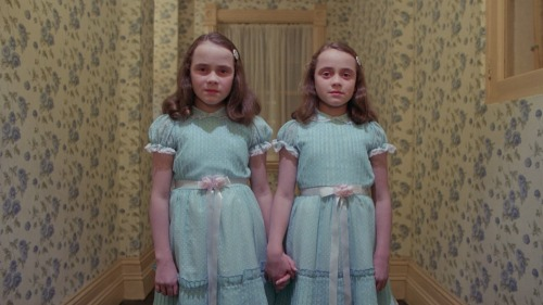 "the-overlook-hotel:  Lisa and Louise Burns were twelve years old when they played the Grady Twins in The Shining. It was the only film appearance for the sisters. In a June, 2002 issue of JANE magazine, the twins, then 35, recalled running around in the Hedge Maze set, getting lost and forcing crew members to remove panels to let them out. They discussed still owning a pair of the dresses they wore in the film, and Louise recalled, ""I got to keep a jar of fake blood. I stored it in the fridge until it congealed."""