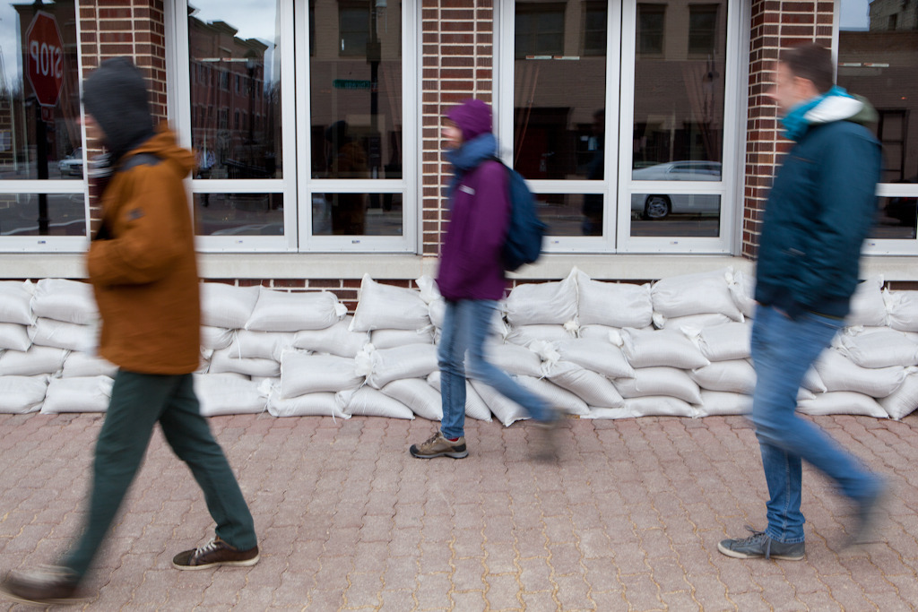 There was a flood this week. Here's some people walking by sandbags. And here's a gallery of more flood stuff, starring photos from Brian Powers, who just won 2nd place in the IPPA's Photographer of the Year competition.