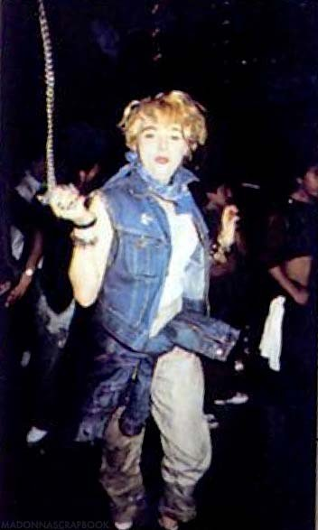 Madonna swinging her chain at a club 1983