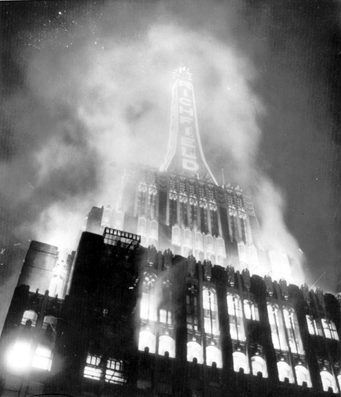 A dramatic photo of the Richfield Tower's spire in flames, 1954. The Art Deco landmark survived the inferno, only to face the wrecking ball in 1969.