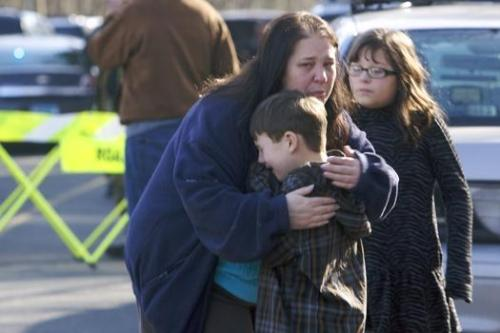 lulzpup:  inothernews:  A child is comforted outside the scene of a school shooting in Newtown, Connecticut.  At least 27 people — including 18 students — were killed.  One gunman is dead and another suspect is in custody.  (Photo: Reuters via The New York Post)  what the fuck