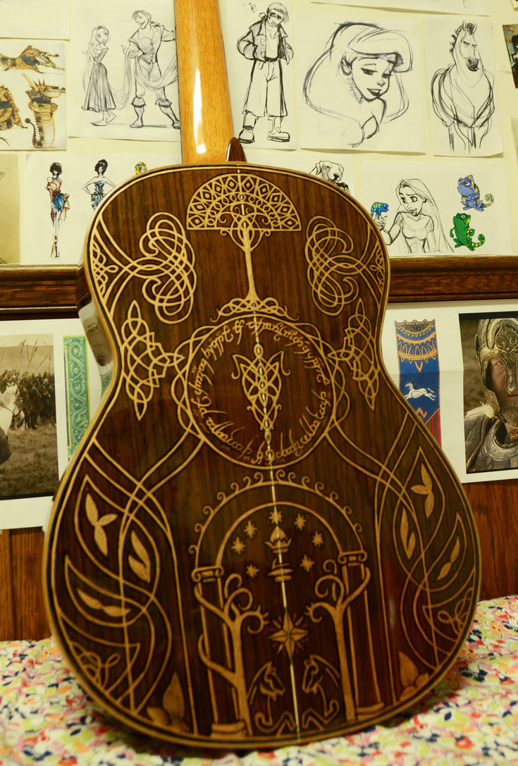 ianbrooks:  LOTR Illustrated Guitar by Vivian Xiao Exquisitely detailed enough to be crafted in the forest realm of Lothlórien, this beauteous guitar was not forged by elf nor man, but by 16 year Vivian Xiao with sharpie markers! Depicting Nazgul, Minas Tirith, and even the all-seeing Eye of Sauron, this divinely-engraved instrument could surely inspire even more Led Zeppelin songs. Check put Vivian's website for details on purchasing and commissions.  Artist: Deviantart / Tumblr / Facebook (via: Obvious Winner)