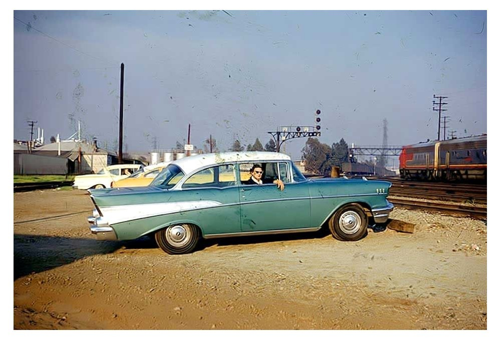 57 Bel Air two door post coupe (my favorite)… and a Santa Fe Super Chief F3 with 'A' and 'B' units in Warbonnet livery. Very cool.