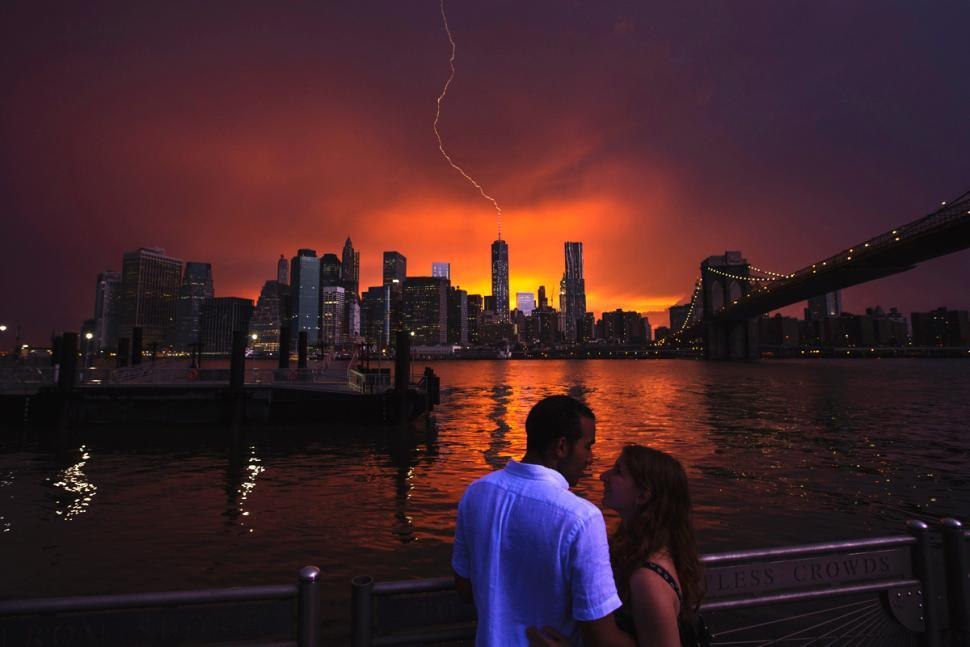 ROARMANCE  Lightning strikes the antenna atop One World Trade Center, as seen from Brooklyn, on Wednesday.  Pounding rains ahead of tropical storm Arthur caused flooding and a partial wall collapse beneath the Brooklyn Bridge. (Photo: Lucas Jackson / Reuters via the New York Daily News)