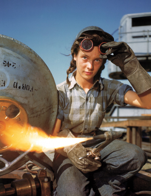 life:  A welder at a boat-and-sub-building yard adjusts her goggles before resuming work, October, 1943. By 1945, women comprised well over a third of the civilian labor force (in 1940, it was closer to a quarter) and millions of those jobs were filled in factories: building bombers, manufacturing munitions, welding, drilling and riveting for the war effort. See more photos here.