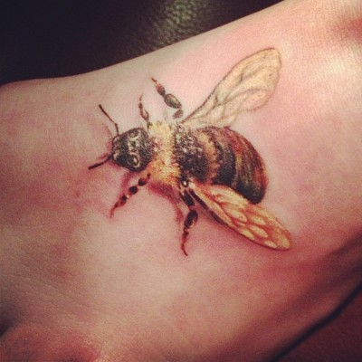 Artist: David Cooper of Sacred Ink Tattoo in Bristol, VA I got this bee on my foot to honor my father and my childhood. I couldn't be(e) any happier with how it turned out!
