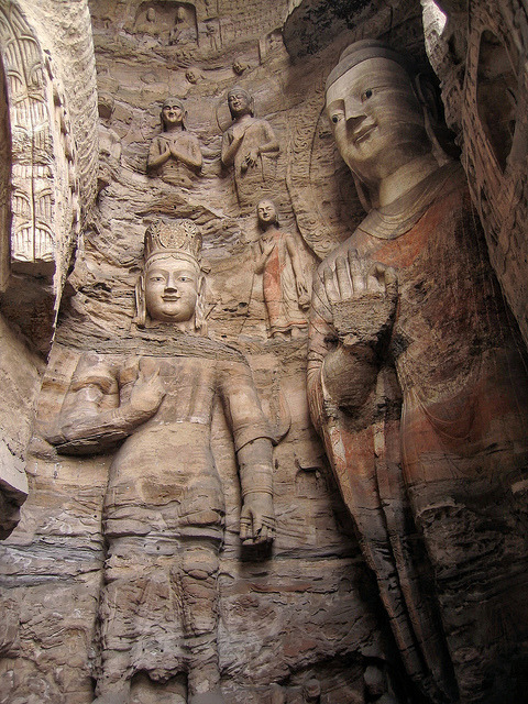 visitheworld:  Stone carved Buddhas at Yungang Grottoes in Datong, China (by Around the World in 480 Days).