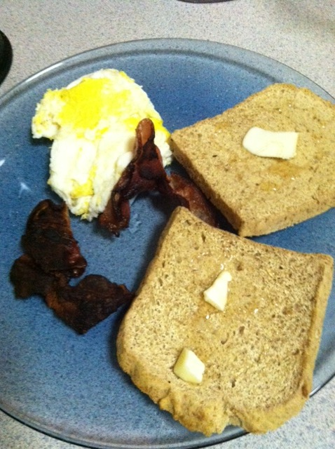 "crossfitcandy:  theangrytherapist reviews Store Bought Paleo Bread and Captures His Inherent Disappointment  in ""The Saddest Paleo Breakfast Photo Known To Man""     Someone posted about Paleo bread on Facebook. With the help of Google, I found a boutique natural foods store 3.2 miles away that carried it. So I get into my car and speed there like a Heroin addict headed downtown. I mean, look at that. Looks like the real deal, right? A cute girl in the nuts aisle smiled at me while passing and I forgot why I was there. Like Nicholas Cage in Weather Man, I had to repeat out loud what I was doing at the grocery store. ""Pale-o bread. Pale-o bread"". Men, predictable. Anyway, bread in the freezer. Not so promising. But I felt hopeful. So I binged at the taco stand right next door because the solution to go from Paleo ""influenced"" to strict Paleo was sitting in my car. So I had a bean burrito and a double cheeseburger and I don't wanna talk about it. I get home, throw my keys, and decide to make my favorite dinner, breakfast. Toast the bread. Slather it with butter and honey with a shit eating grin on my face like I was about to have makeup sex.  I take a bite. Drum roll… Holy shit! What do I think about this 8 dollar loaf of ""bread""? Fucking disgusting. Don't let that photo fool you. It tasted like a thin dry sponge with dishwashing soap on it. No joke. Not exaggerating. That's exactly what it tasted like. I almost spit it out. So disappointed.  Last night was my ""cheat"" day. I had wood fire pizza dough that was so amazing, I wanted to roll around in it naked and make love to it. Apples and oranges, guys. There is no bread substitute.  I say if you're going to eat bread, just eat bread. The difference between real bread and Paleo bread is like crackers and wet crackers. But do it in moderation like I try. And if you're not, then don't. But all this Paleo bread bullshit is only going to get your hopes up and mad at yourself because you should have talked to the girl at the grocery store. What?  - Angry     PS I have it on good authority, though, that cookingcaveman has an awesome recipe for paleo bread that's super easy to make & delicious.  #crossfitcandy"