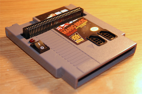 retrogamingblog:  NES made from a NES Cartridge If someone makes a Playstation system out of a Playstation disc, the universe will probably implode…