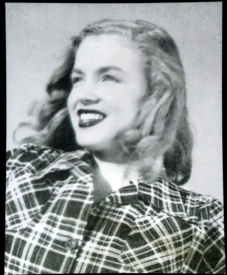 """ANSWER FOR PHOTO QUIZ #7 The question was: Who's the famous lady in this vintage negative? (see Photo Quiz #7)   HI, MY NAME IS … The mysterious lady isn't Judy Garland, Lauren Bacall, Jackie Kennedy, Bette Davis, Audrey Hepburn, Leni Riefenstahl or Maggie the """"Ermahgerd"""" girl. Actually it'sMarilyn Monroe (aka Marilyn Monroe Miller aka Norma Jeane Mortenson aka Norma Jeane Baker aka Norma Jeane DiMaggio aka Norma Jeane Dougherty) in her younger years, photographed by Joseph Jasgur in 1946. Trivia: The model release was signed with """"Norma Jeane Dougherty"""" (+):   AND THE WINNER IS … Congratulations to therealsnowhite89 who first came up with the right answer; even though her answer was only 'Marilyn' (which would be her), but let's not nit-pick… and to be serious: there's only one Marilyn, right?! Your price is this picture of Marilyn Monroe standing next to Snow White, I hope you like it! Or maybe you like this one better:   © Paolo Schmidlin, Sculpture of Marilyn Monroe in coffin (Snow White style)  MORE WINNERS & MORE THANKS More congratulations to mezzaluna, obitoftheday (great guess!), minusmanhattan, Jori, unkledic,hoodoothatvoodoo, honey-rider, littlebunnysunshine, firsttimeuser, mudwerks & undr (thanks for artist & date information) who also came up with the right answer! Thanks for not cheating - or admitting that you've cheated :) and thanks to all of you who participated, I hope you had some fun! For some of you it was too easy, maybe you find a more challenging quiz here.  ABOUT THE NEGATIVE The negative of this photograph was on auction at LiveAuctioneers.com yesterday, Jan. 13, 2013 (presented by L. Joe Moss Antiques & Auctions). What I don't get is that it looks exactly like a crop of the picture below (source). I combined the two pictures in Photoshop and set the opacity of the inverted-negative layer to 60%. Somehow strange. Is it maybe only a negative that shows a photographed detail of a large print?    SUGGESTIONS FOR FUTURE PHOTO QUIZ QUESTIONS? I"""