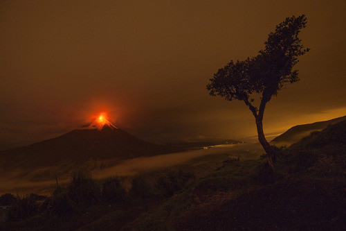 inothernews:   The Tungurahua volcano erupts outside Cotato, Ecuador.  (Photo: Jose Jacome / EPA via The Guardian) Beautiful and destructive.