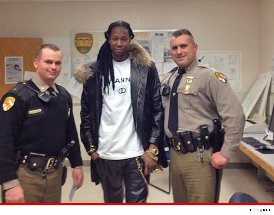 Cops arrested 2 Chainz and then posed for photos with him.