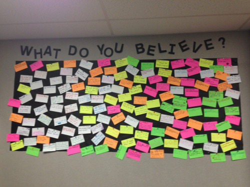 "Before we started our ""This I Believe"" unit, on an index card, I had the students write down two questions they had about the word, ""belief"" or write down one thing that they believed in. Their questions turned into great essential questions to help me backwards plan the rest of the unit. Of course, using the neon-colored index cards just made it more attractive on the wall! Then, I had my student-aide hang everything up. You have to not care if anything is straight when you ask your student-aide to hang things for you; it is the beauty of having a student-aide in middle school."