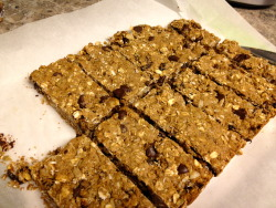 Oatmeal Cookie Granola Bars I used a couple of different recipes for oatmeal cookies, veganized them, and made a couple of substitutions and augmentations - kind of made it up as I went along.   And, it worked!  They are really good! What in 'em: Whole Wheat Flour, Whole Rye Flour, Oats, Shredded Wheat Cereal, Raisins, Chocolate Chips, Sunflower Seeds, A Flax Egg, Raw Sugar, Cinnamon, Almond Butter, and Peanut Butter.   Oh, and little baking soda.  Yep - snacks for my son.