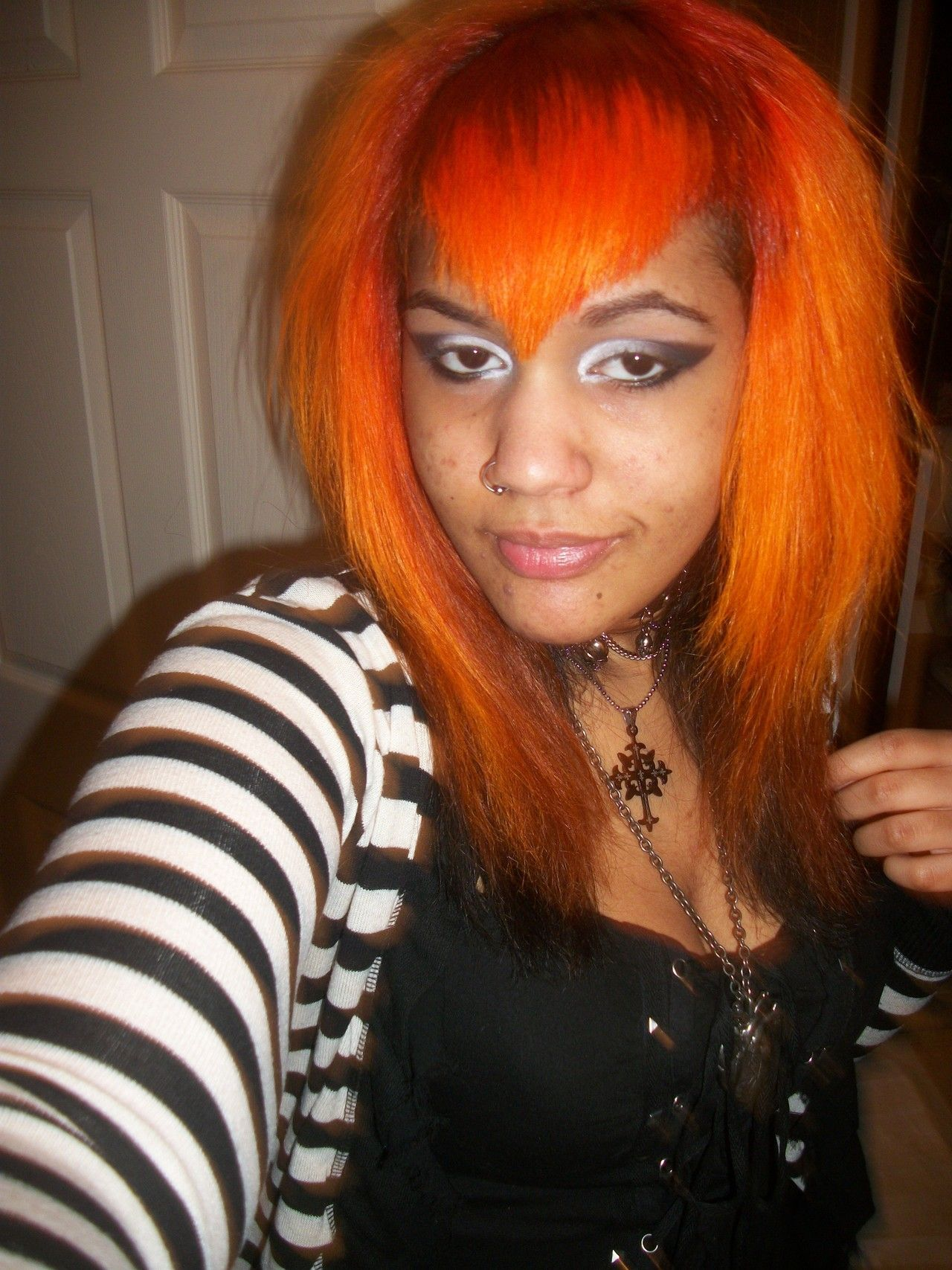 [image: mixed goth with orange hair and black and white eye makeup]  Me before school the other week.