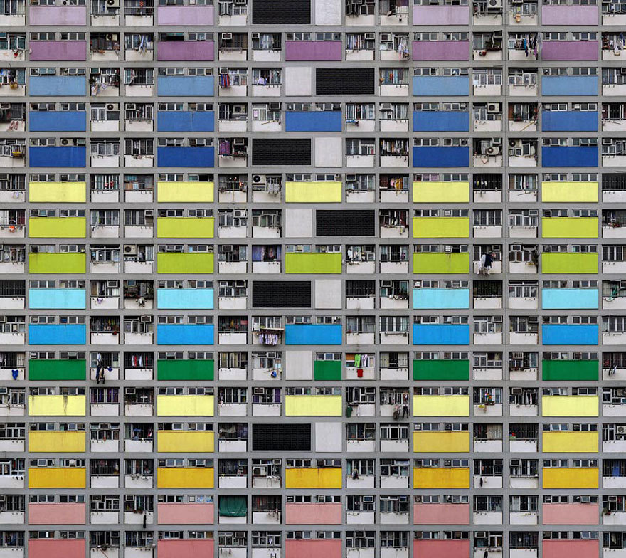 Architectural Density in Hong Kong With seven million people, Hong Kong is the 4th most densely populated places in the world. However, plain numbers never tell the full story. In his 'Architecture of Density' photo series, German photographer Michael Wolf explores the jaw-dropping urban landscapes of Hong Kong. He rids his photographs of any context, removing any sky or horizon line from the frame and flattening the space until it becomes a relentless abstraction of urban expansion, with no escape for the viewer's eye. Infinite and haunting. Editor's Note: Co-signed.