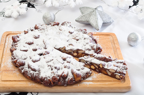 Panforte, or panepepato, is a typical Tuscan Christmas cake. The first written evidence of panforte dates back to the year 1000, when it was called Pane Natalizio (Christmas Bread). This cake were made by spice sellers, who were the pharmacists of the day, and was only prepared for local aristocrats, the very rich and the clergy as it contained ingredients like orange, citrus, melon, almonds and expensive spices. Preparation time: 35 minutes Serves: 10 to 12 Ingredients 80g flour 1 tsp ground cinnamon 1/2 tsp ground star anise 1 tsp vanilla extract 200g figs, chopped 100g hazelnuts 150g almonds 100g dark chocolate, coarsely chopped 1 orange, zested 150g castor sugar 150g honey 50g water icing sugar to dust Preparation Preheat the oven to 150ºC bake. Grease and line a 20cm round cake tin. Sift the flour, cinnamon and star anise. Add the figs, nuts, chocolate, orange zest and vanilla extract and mix to combine. Place the sugar, honey and water in a saucepan and slowly bring to the boil over medium heat, stirring until the sugar dissolves. Bring to the boil and boil about 10-15 minutes, until the mixer begin to thick. Immediately pour the sugar mixture over the flour mixture and mix quickly with a wooden spoon until well combine. Quickly spoon out the mixture into the greased tin and bake for 15 minutes. Cool well before taking out of the pan. Sprinkle generously with icing sugar. Store in an airtight container.
