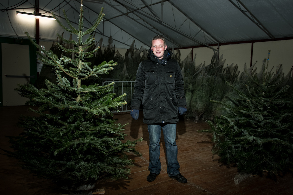Christmas tree shop. La Richardais, Bretagne France. He was living in new Caledonia and he just arrived to town. His friend could not do the job so he is a remplasant for the season. The place was like a fridge.