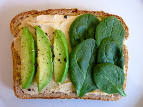 mrsjonie:  Toast with hummus, spinach, avocado and cracked pepper. I would add some jalapeno to this too and some turkey ham, I just adore hummus! To bad I can't find in here, I have to go to Calexico.