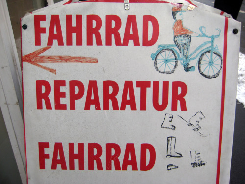 One of the many hand-drawn signs at a small bicycle and ski sales and repair shop in Graz, Austria.