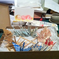 Preparing a package of a Paper Crane Mobile, and my painting for the week .. #makingsales #etsy