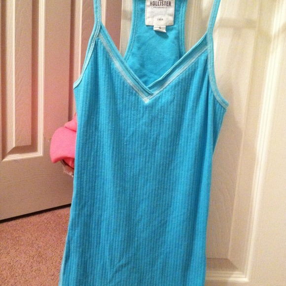 I just added this to my closet on Poshmark: Hollister Tank. Turquoise so cute! Great condit.. (http://bit.ly/XPHj1r) #poshmark #fashion #shopping #shopmycloset