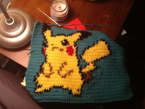 cadaveriine:  So this is what I did all day. It's a crochet version of a pikachu sprite. I'm thinking of making a pokemon blanket loooool. It kinda looks like poop tho