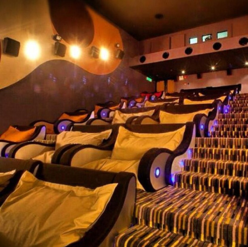 squigglydigg:  brooklyn-bridge:  A movie theatre you can cuddle in  BRING THIS TO MY TOWN  omg, I just want to take one seat and stretch out.  Movie seats are kind of confining for me.