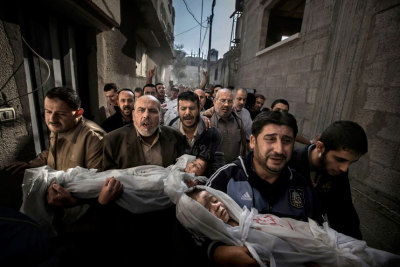 World Press Photo of the Year 2012 contest winners newsflick:  Paul Hansen of Sweden, a photographer working for the Swedish daily Dagens Nyheter, has won the World Press Photo of the Year 2012 with this picture of a group of men carrying the bodies of two dead children through a street in Gaza City taken on November 20, 2012. Jury member Mayu Mohanna said about the photo: The strength of the picture lies in the way it contrasts the anger and sorrow of the adults with the innocence of the children. It's a picture I will not forget.  Picture: REUTERS/Paul Hansen/Dagens Nyheter/World Press Photo