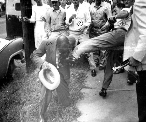 historicaltimes:   White agitators kick a black man outside Central High School in Little Rock, Arkansas during racial desegregation protests in September 1957 - Read More